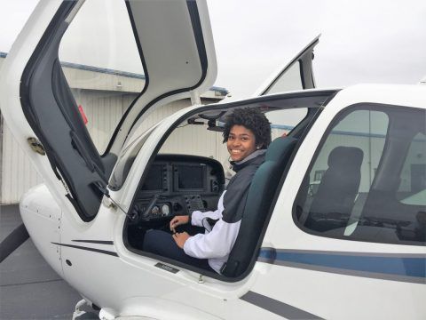 Teen In Cockpit of Small Airplane