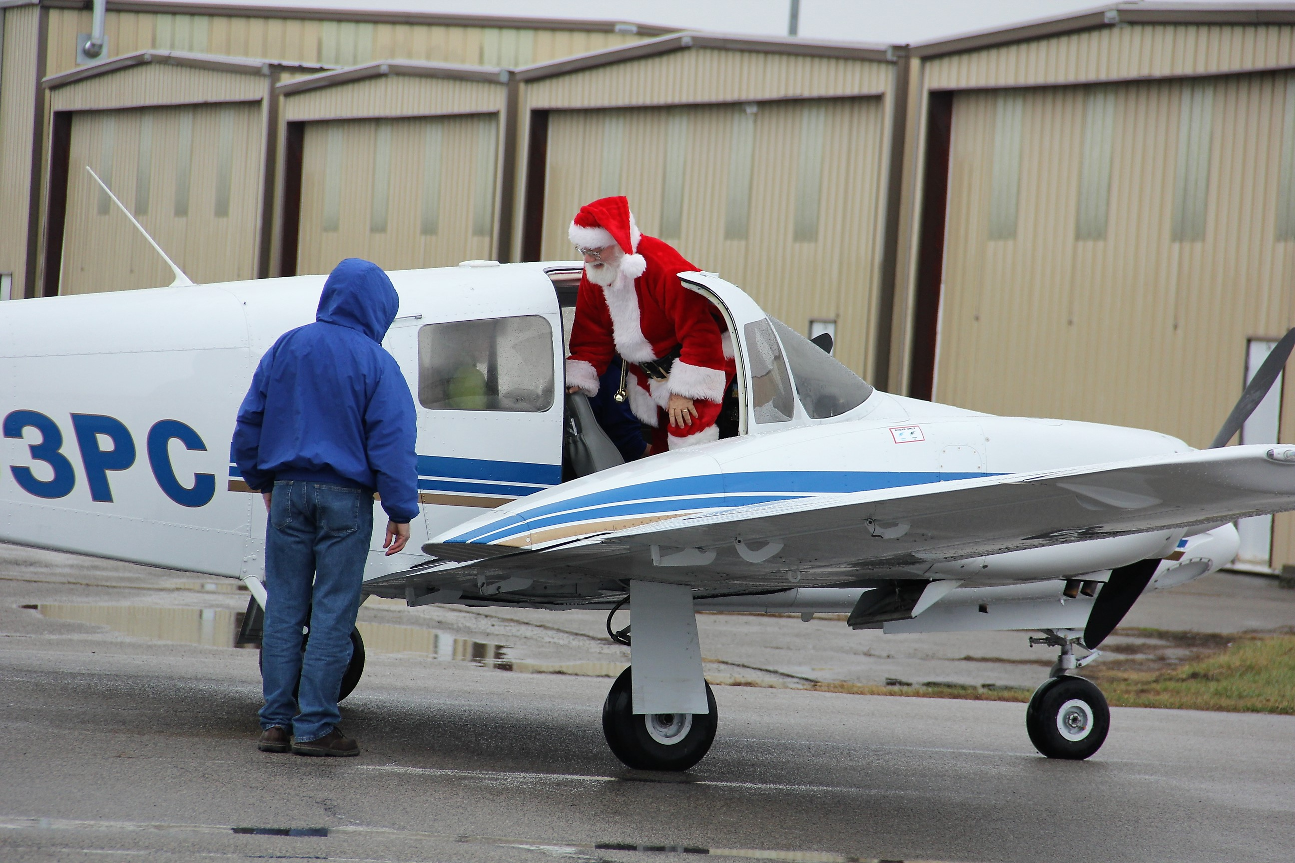Santa Exits Airplane