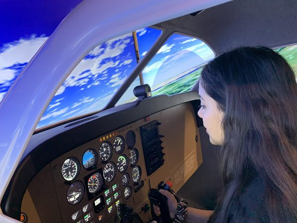 Girl Piloting Flight Simulator