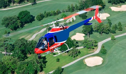 KCPS helicopter in the air over a golf course
