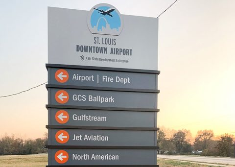 Sign showing various directions to locations