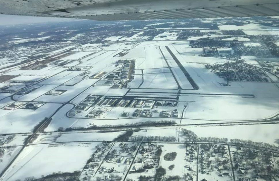 St. Louis Downtown airport during a winter strorm overhead view with snow everywhere.
