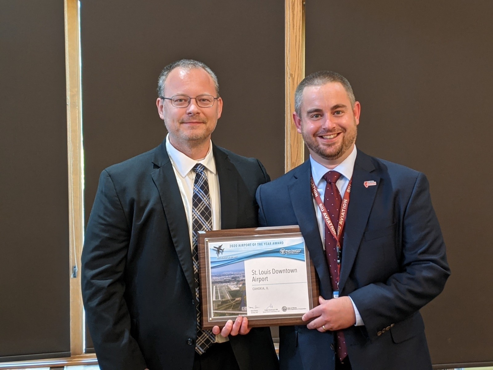 Erick Dahl, Director of St. Louis Downtown Airport (KCPS), accepts the 2020 Reliever Airport of the Year Award from Clayton Stambaugh, MPA, Deputy Director of Aeronautics for the Illinois Department of Transportation.